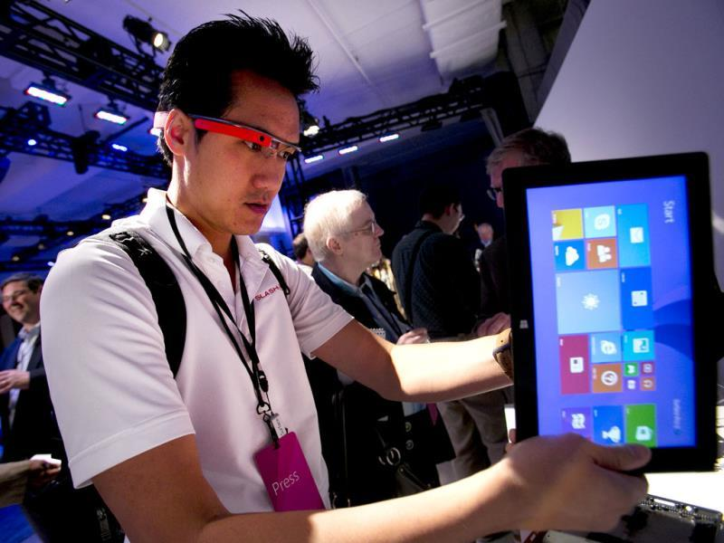 Vincent Nguyen, Editor in Chief of SlashGear, wears Google Glass while covering the introduction of the Microsoft Surface 2 in New York. Photo: AP/Mark Lennihan