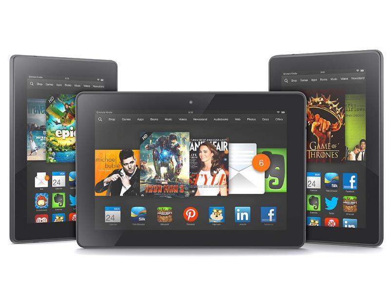 The 8.9-inch Amazon Kindle HDX tablet computer, center, the 7-inch Kindle HDX, left, and the updated Kindle HD. Photo: AP/Amazon.com