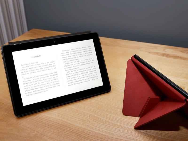 The 8.9-inch Amazon Kindle HDX tablet computer is shown at left next to the 7-inch Amazon Kindle HDX, shown at right on the optional folding 'Origami' stand that also protects the screen when not in use in Seattle. Photo: AP/Ted S. Warren