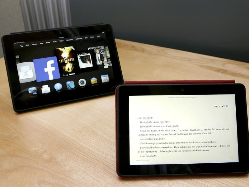 The 8.9-inch Amazon Kindle HDX tablet computer is shown at left next to the 7-inch Amazon Kindle HDX, right in Seattle. Photo: AP/Ted S. Warren