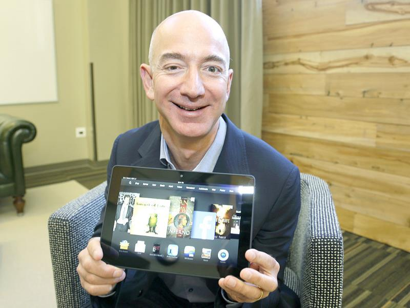 Jeff Bezos, CEO of Amazon.com, poses for a photo with the 8.9-inch version of the new Amazon Kindle HDX tablet computer in Seattle. Photo: AP/Ted S. Warren