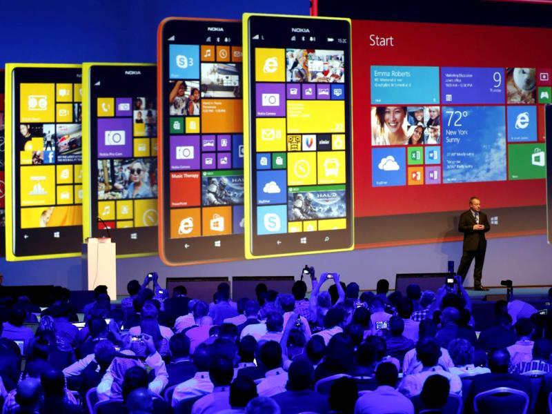 Nokia CEO, Canadian Stephen Elop, unveils Nokia latest products during an event in Abu Dhabi. Nokia has unveiled its first phablets -extra-large phones- and its first tablet computer. Photo: AFP / Karim Sahib