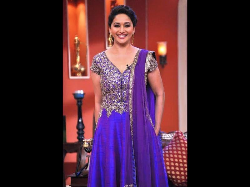 Madhuri Dixit strikes a pose on the sets of Comedy Nights with Kapil.