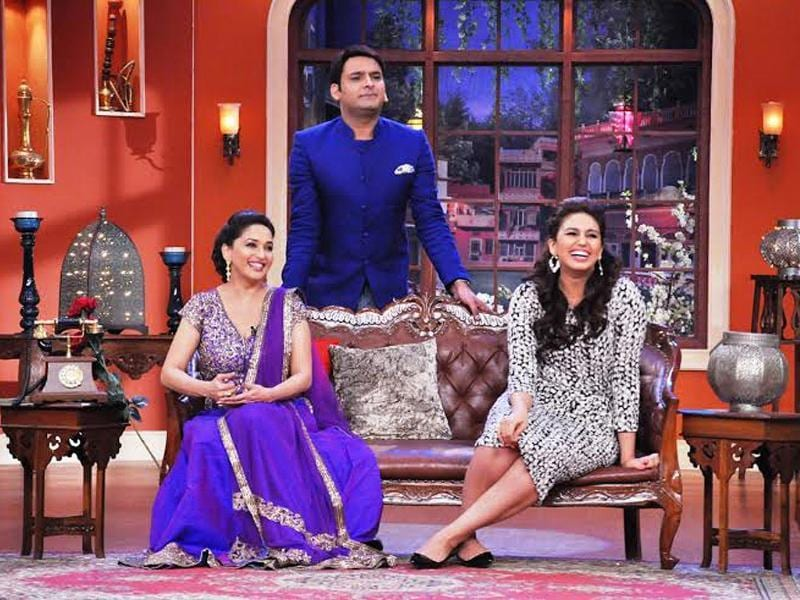 Madhuri Dixit and Huma Qureshi visited the sets of Comedy Nights with Kapil recently to promote Dedh Ishqiya. The show's host and producer Kapil Sharma tried his best to charm the gorgeous ladies and so did other characters on his sets. The episode will be aired on December 22. Take a look.