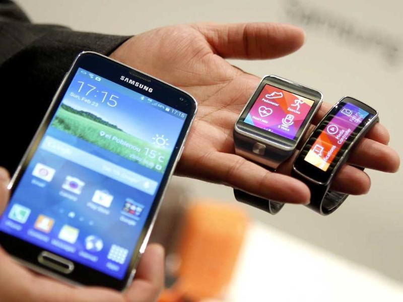New Samsung Galaxy S5 smartphone, Gear 2 smartwatch and Gear Fit fitness band are displayed at the Mobile World Congress in Barcelona. (Reuters photo)