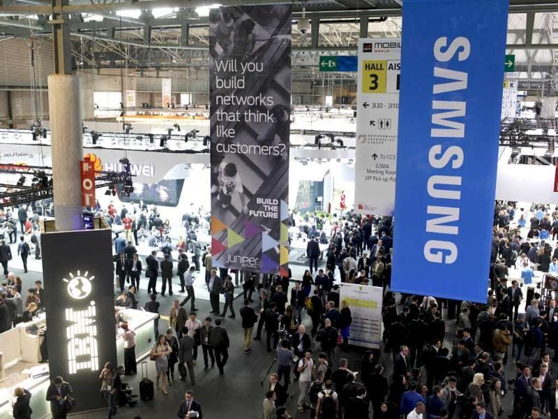 People walk around Hall 3 at the Mobile World Congress in Barcelona. (AFP photo)