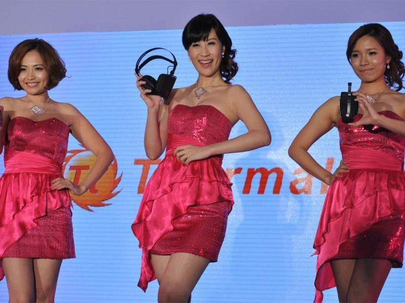 Models display new products during a pre-show press conference ahead of the Computex trade fair in Taipei. Photo: AFP / Mandy Cheng