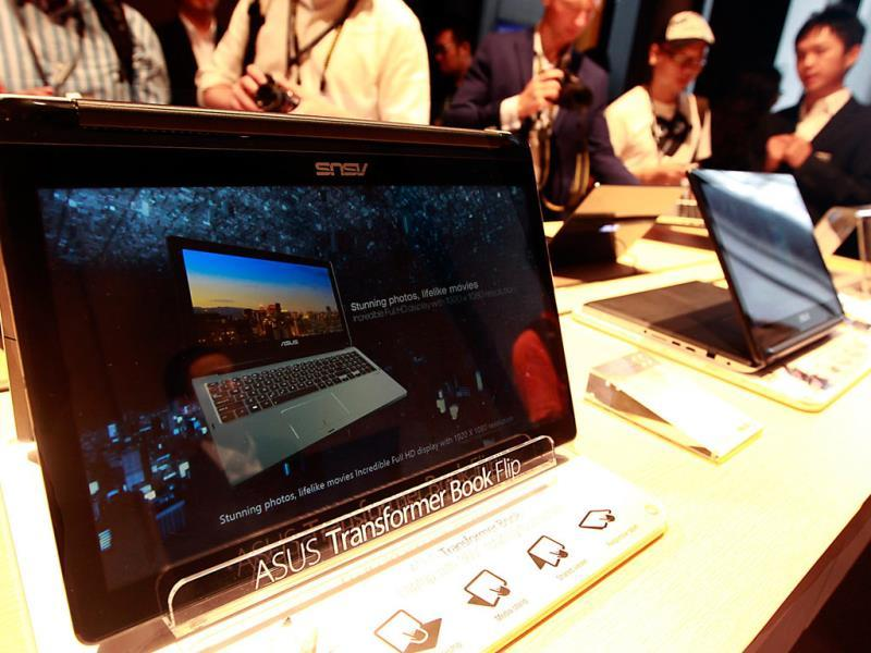 ASUS Transformer Book Flip laptops are displayed during its news conference as part of a media preview of the 2014 Computex exhibition in Taipei. Reuters/Pichi Chuang