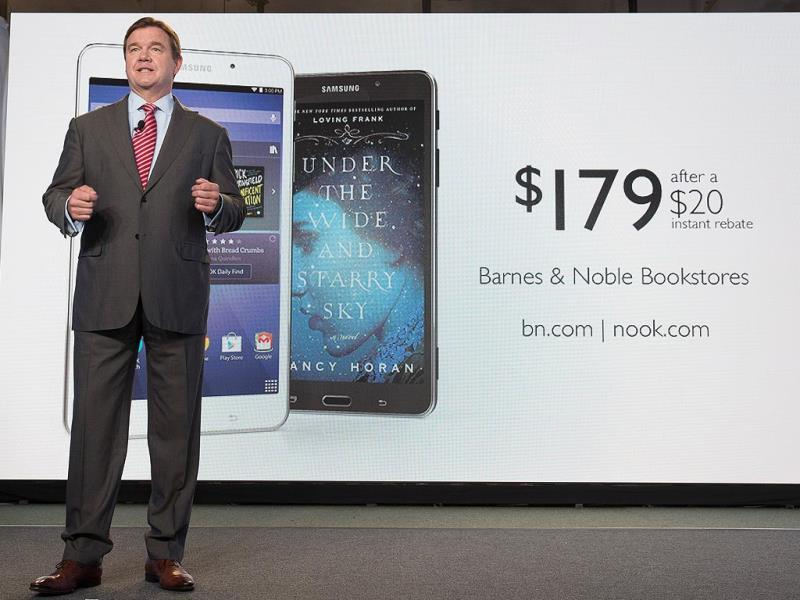 Mike Huseby, CEO of Barnes & Noble, speaks during the unveiling of a new Barnes & Noble and Samsung co-branded tablet called the Samsung Galaxy Tab 4 Nook that will replace B&N's own Nook tablets in New York. (AP Photo/John Minchillo)