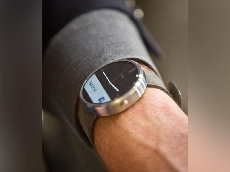 Steve Sinclair, Motorola's vice president of product management, shows the new Moto 360 circular smartwatch, the company's first, during an interview on August 27, 2014. (AP/Bebeto Matthews)