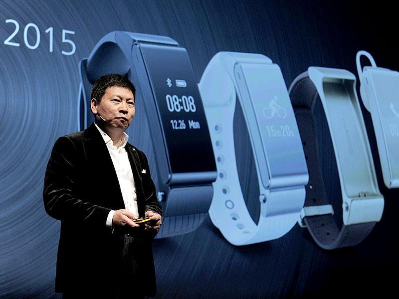 Huawei's Consumer Business Group Chief Executive Officer (CEO) Richard Yu presents his company's new device 'Talkband N1' during a press conference in Barcelona. Photo: AFP