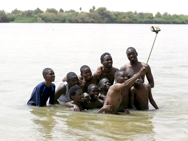 A group of young men use a selfie stick to take a picture of themselves in shallow waters known as the first cataract of the River Nile outside Khartoum, Sudan. (Reuters Photo)