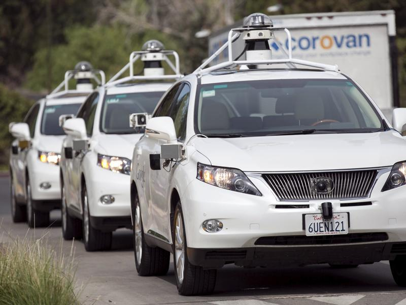A line of Lexus SUVs equipped with Google self-driving sensors await test riders during a media preview of Google's prototype autonomous vehicles in Mountain View, California (REUTERS)