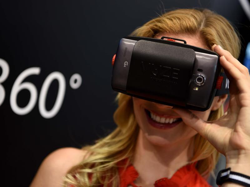 A visitor takes a 360 degree view with virtual reality glasses on at the Vuze stand at Photokina. 2016. The fair includes the cutting edge technology in the world of photography.  (Patrik Stollarz / AFP)