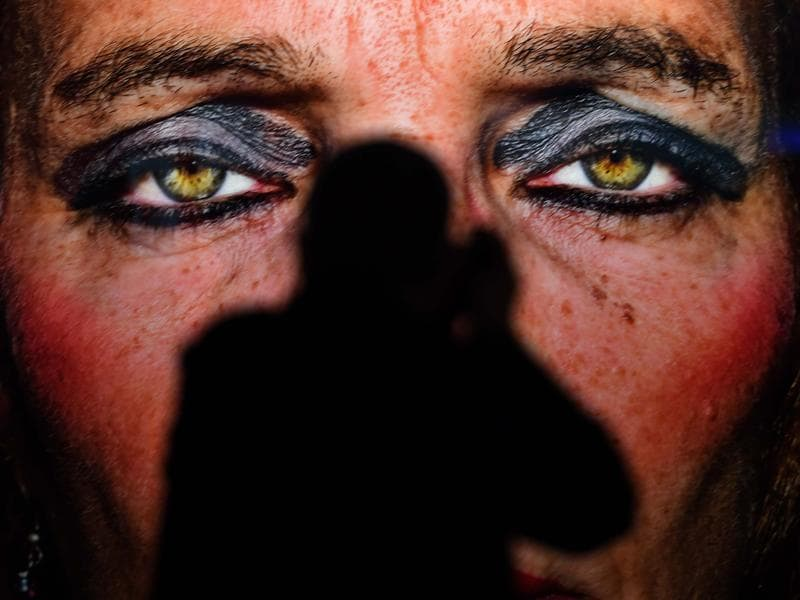 Photokina also includes a program of events with congresses, workshops, symposiums and photography exhibitions. A visitor stands in front of a portrait taken by artist Bruce Gilden at the 'Masters of Photography' exhibition at the trade fair in Cologne.   (Patrik Stollarz / AFP)