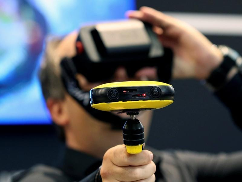 A journalist checks out the Vuze 3D 360 video camera at the Vuze booth on the Photokina. There's something for everybody at this year's  fair! (Fabrizio Bensch / REUTERS)