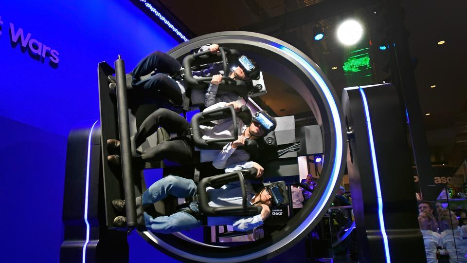 Attendees participate in a Samsung virtual reality ride at CES 2017 at the Las Vegas Convention Center in Las Vegas, Nevada.