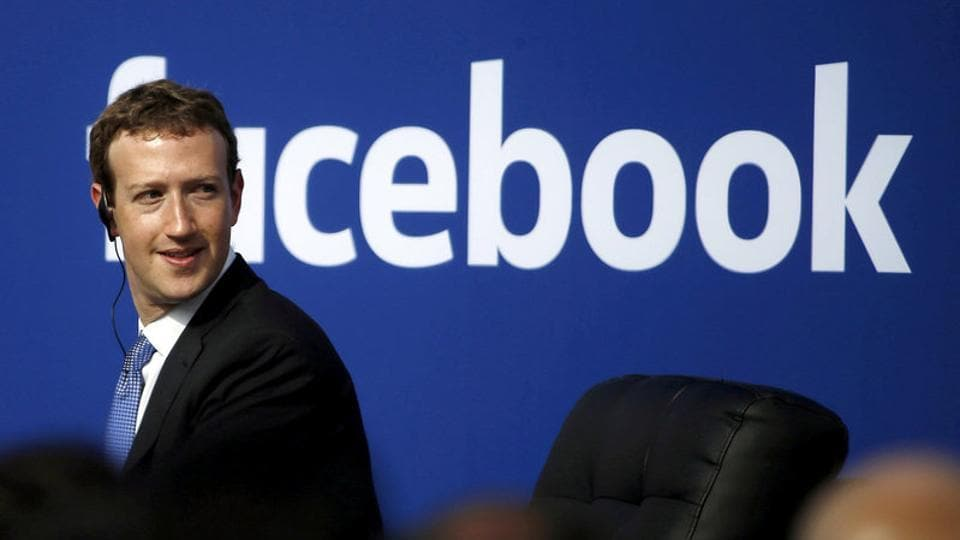 Facebook CEO Mark Zuckerberg is seen on stage during a town hall at Facebook's headquarters in Menlo Park, California.