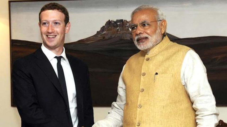 Mark Zuckerberg, founder and CEO of Facebook, shakes hands with Prime Minister Narendra Modi before their meeting in New Delhi.
