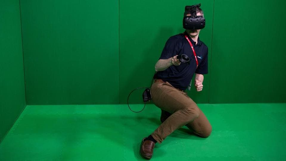 A visitor uses a VR device during the Mobile World Congress  (AFP)