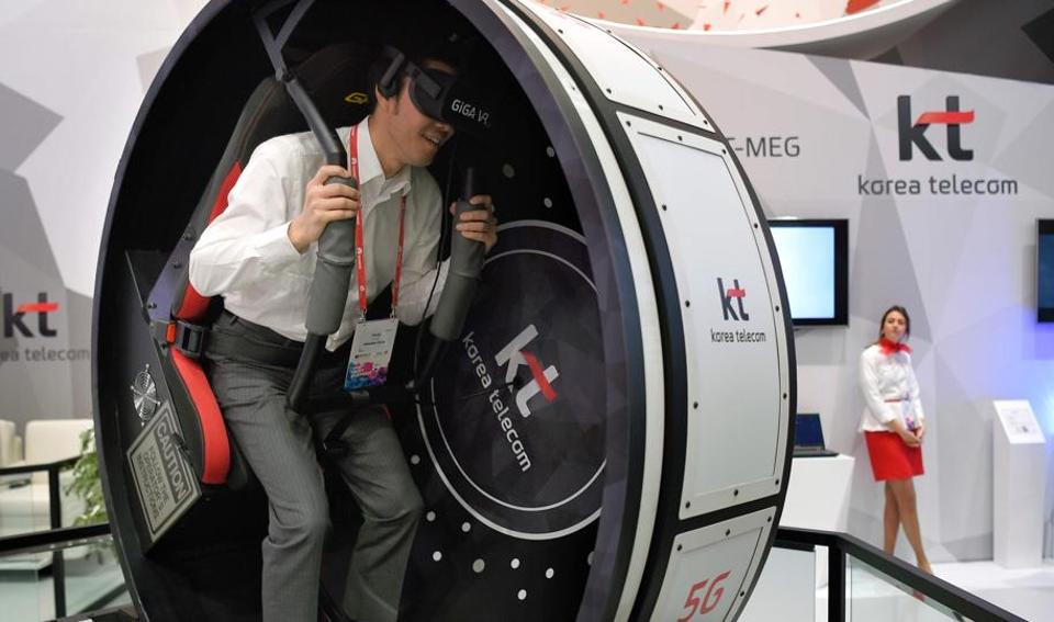 A visitor tests  the 'Korea VR Tour' in the stand of KT -Korea Telecom (AFP)