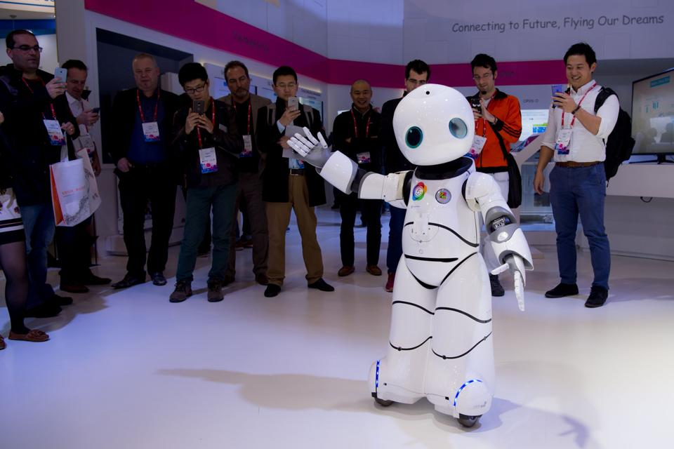 A robot dances on a Chinese mobile company's stand during the Mobile World Congress in Barcelona. (AFP)