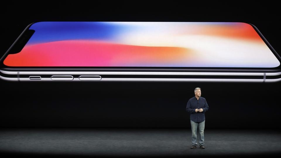 Phil Schiller, Apple's senior vice president of worldwide marketing, discusses features of the new iPhone X at the Steve Jobs Theater on the new Apple campus on Tuesday.