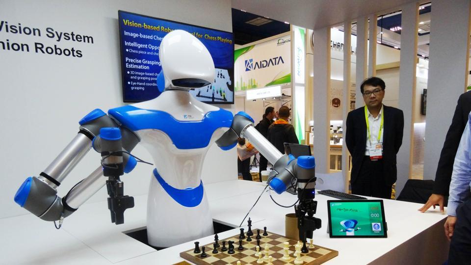 This file photo taken on January 08, 2017 shows a robot developed by Taiwan engineers moving chess pieces on a board against an opponent at the 2017 Consumer Electronic Show (CES) in Las Vegas, Nevada.