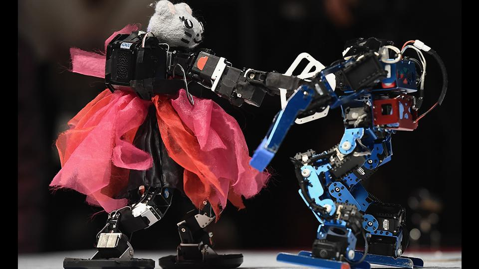 Two humanoid robots spar during the 32nd ROBO-ONE tournament in Tokyo, Japan. The ROBO-ONE is a bi-annual fighting competition for bipedal walking robots, aiming to share advances in robotics and spread the popularity of bipedal walking robots among enthusiasts. (Matt Roberts / Getty Images)