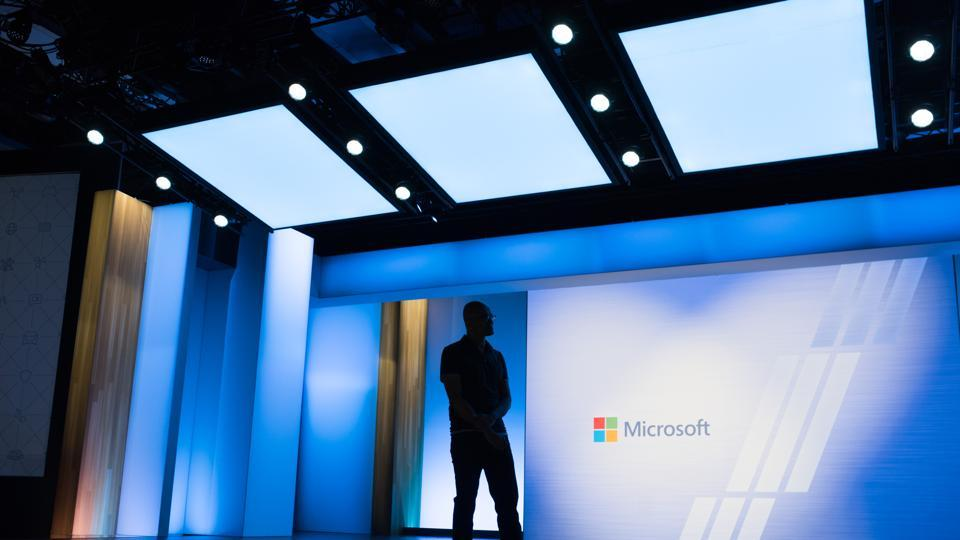 Satya Nadella, CEO of Microsoft watches a video during the Microsoft Developers Build Conference in Seattle.