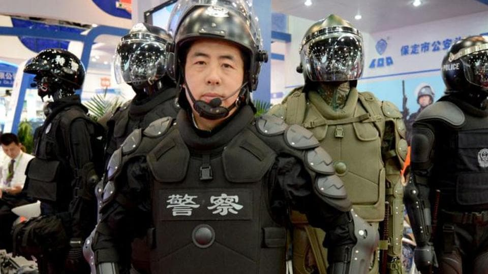 Police equipment on display at the Asia Pacific China Police exhibition in Beijing. A Chinese company says it has developed a laser weapon that can be used by the police to control protesters.