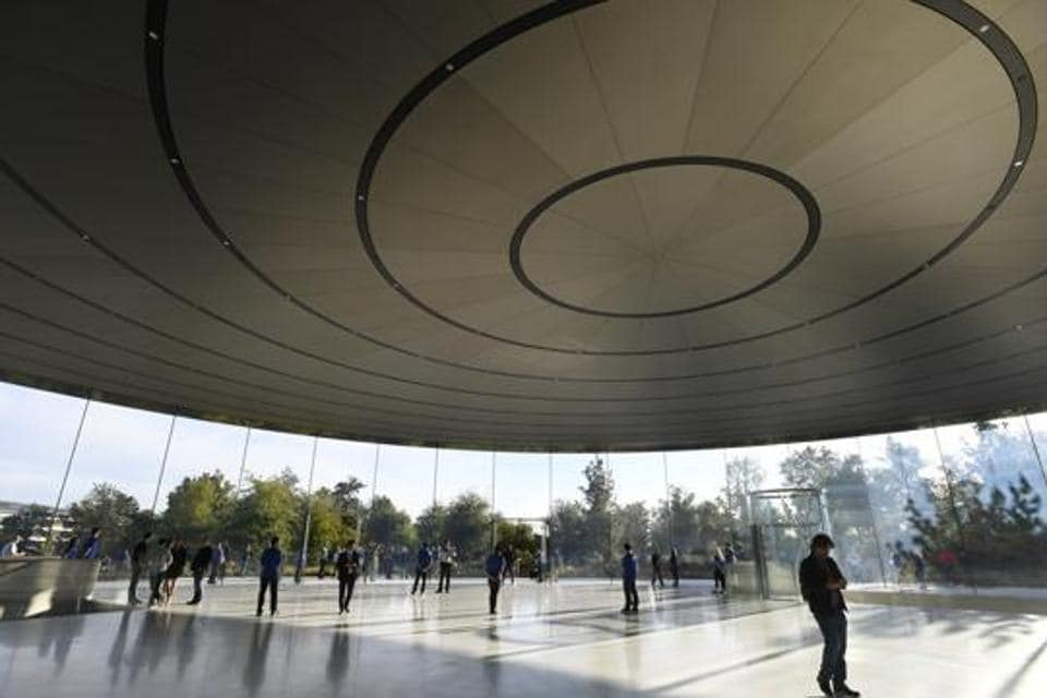 Employees stand among attendees ahead of an Apple Inc. event at the Steve Jobs Theater in Cupertino, California, US, on Wednesday, September 12, 2018.