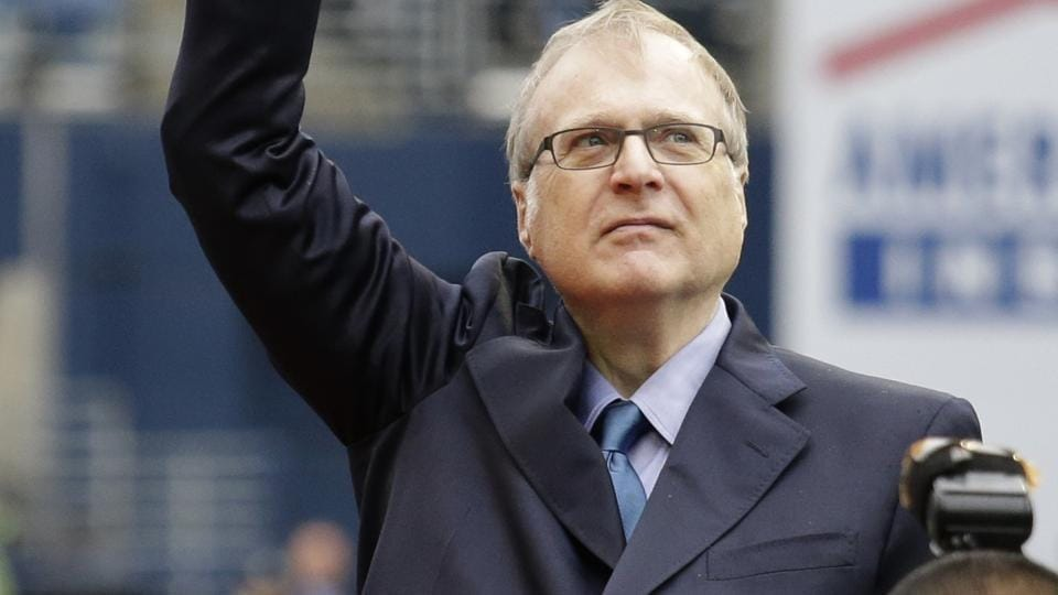 Seattle Seahawks owner Paul Allen waves as he is honoured for his 20 years of team ownership before an NFL football game against the San Francisco 49ers in Seattle.