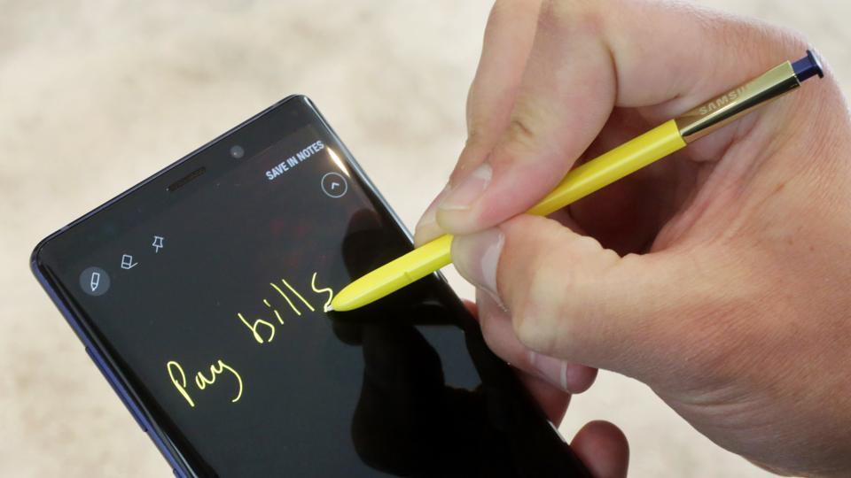 In this Aug. 7, 2018, file photo the Samsung Galaxy Note 9 and stylus are shown in New York. The stylus now acts as a remote control for triggering the camera shutter or pausing and forwarding songs.