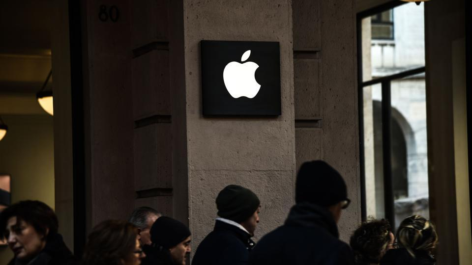 Pedestrians walk near the Apple Store in Via Roma in Turin on January 5, 2019.