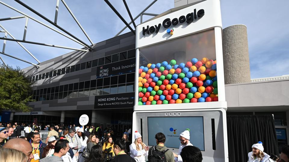 Attendees wait in line to ask questions of Google Assistant at a giant