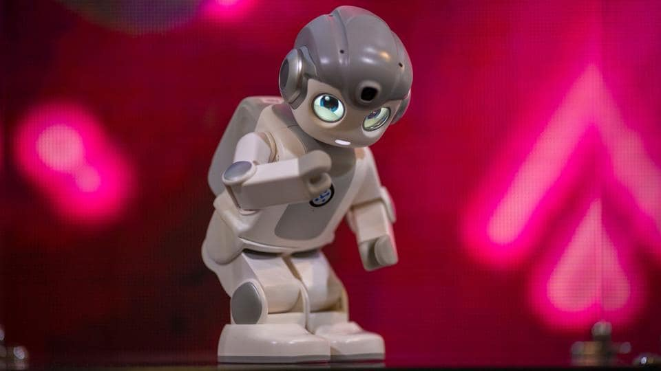 An Alpha Mini robot that use artificial intelligence dances at the Las Vegas Convention Center during CES 2019 in Las Vegas on January 10, 2019.