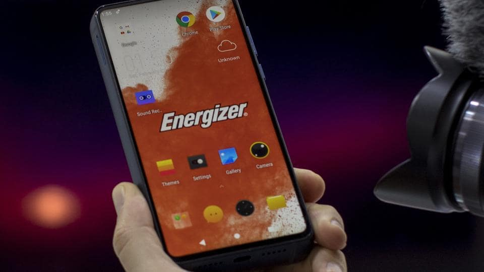 A visitor holds a new model of P18K POP Energizer phone, with 18,000mAh battery, at the Mobile World Congress wireless show