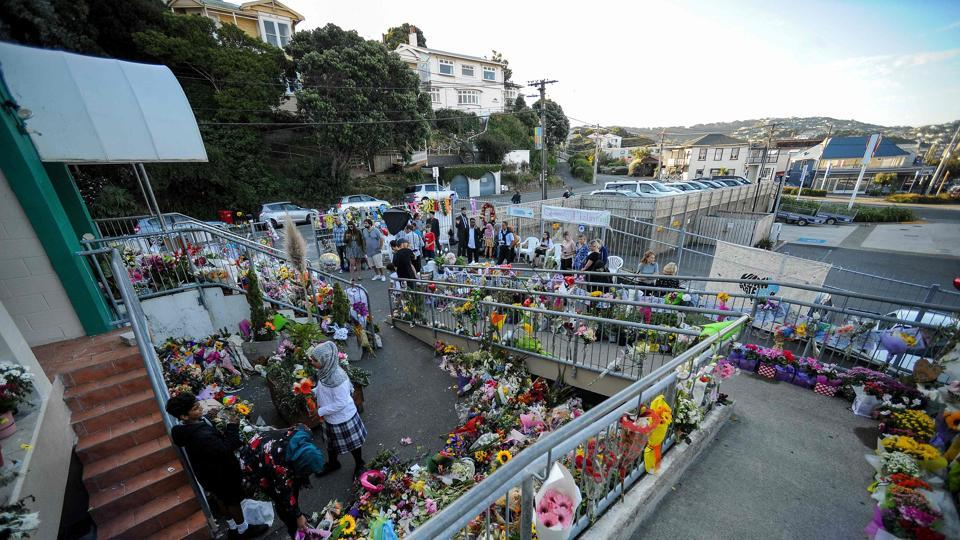 Residents place flowers at a memorial site for the Christchurch mosque attacks victims at Islamic Center in Kilbirnie, Wellington on March 19.