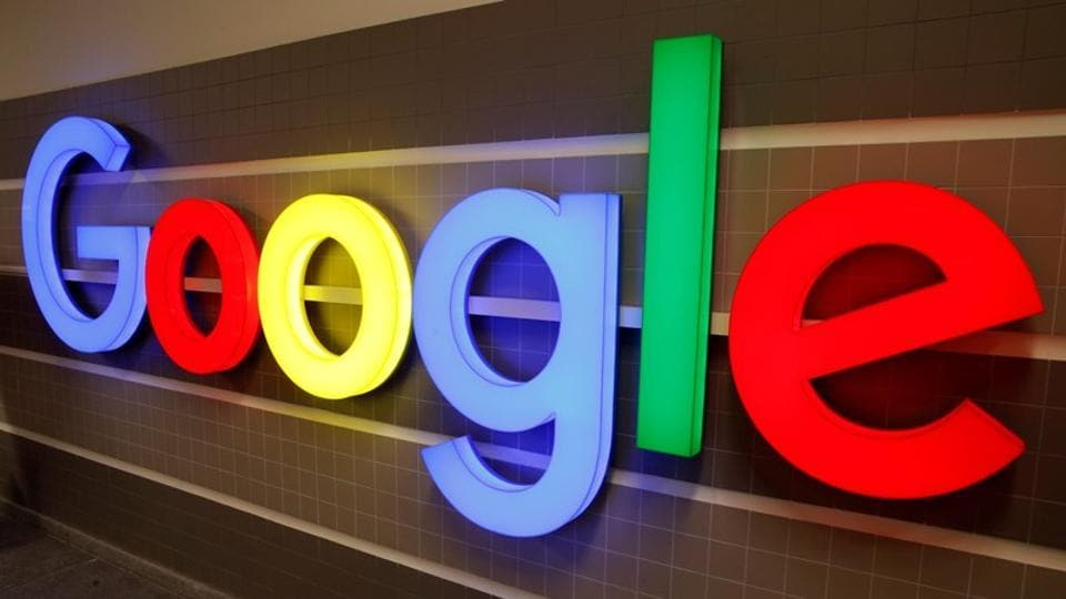 FILE PHOTO: An illuminated Google logo is seen inside an office building in Zurich, Switzerland December 5, 2018. REUTERS/Arnd Wiegmann/File Photo