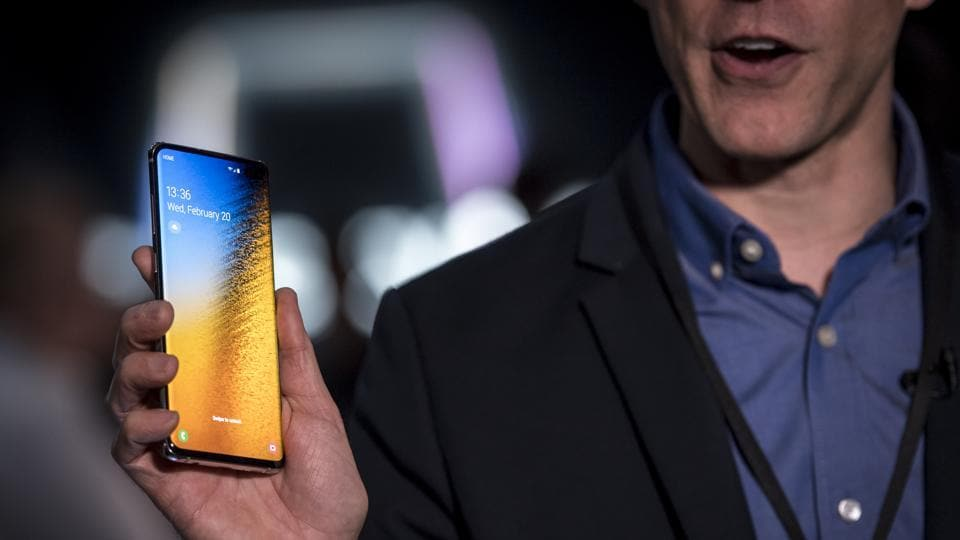 A member of the media holds a Samsung Electronics Co. Galaxy 10+ smartphone during the Samsung Unpacked launch event in San Francisco, California, U.S. on Wednesday, Feb. 20, 2019. Samsung debuted its most extensive new lineup of smartphones, taking on Apple Inc. amid a slowing market with new low-end and premium models, 3-D cameras, an in-screen fingerprint scanner and faster 5G connectivity.