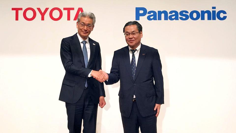 Toyota Motor Corporation Operating Officer Masayoshi Shirayanagi shakes hands with Panasonic Corporation Senior Managing Executive Officer Makoto Kitano during their joint news conference in Tokyo, Japan May 9, 2019.