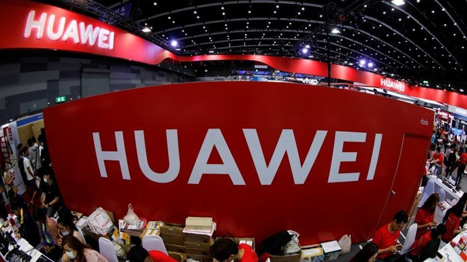 Workers sit at the Huawei stand at the Mobile Expo in Bangkok, Thailand, May 31, 2019.
