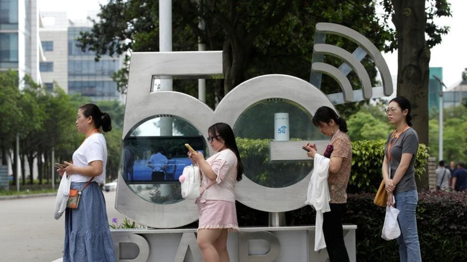 Employees wait for a shuttle bus at a 5G testing park at Huawei's headquarters in Shenzhen, Guangdong province, China May 29, 2019.