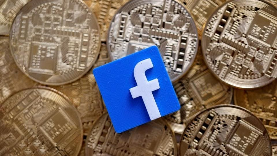A 3D printed Facebook logo is seen on representations of the Bitcoin virtual currency in this illustration picture, June 18, 2019.