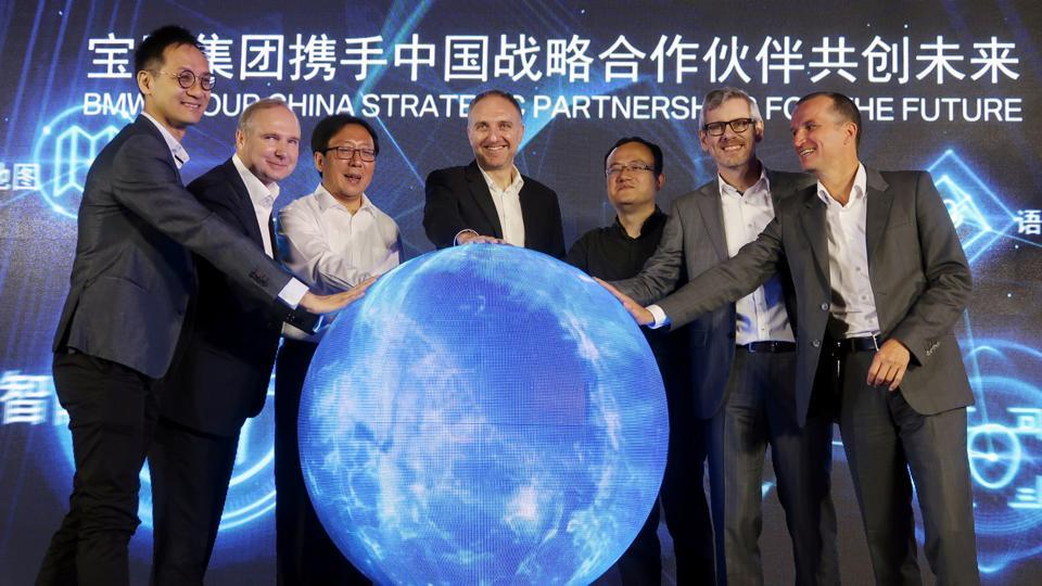 Jochen Goller (2nd L), head of BMW's China operations, and other executives attend an event announcing the German automaker's partnership with China's Tencent Holdings in launching a computing center for self-driving vehicles, in Beijing, China July 19, 2019.