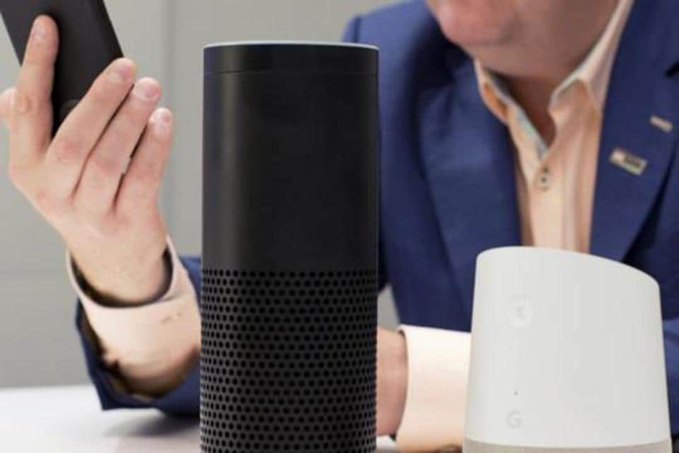 Amazon Echo, center, and a Google Home, right, are displayed in New York.