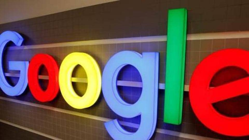 FILE PHOTO: An illuminated Google logo is seen inside an office building in Zurich, Switzerland, December 5, 2018. REUTERS/Arnd Wiegmann/File Photo