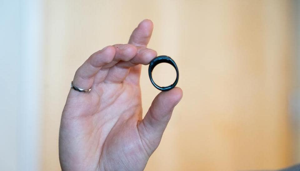 A worker holds an Amazon.com Inc. Echo Loop smart ring during an unveiling event at the company's headquarters in Seattle, Washington, U.S., on Wednesday, Sept. 25, 2019.