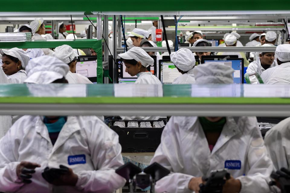Employees test mobile phones on an assembly line in the mobile phone plant of Rising Stars Mobile India Pvt., a unit of Foxconn Technology Co., in Sriperumbudur, Tamil Nadu, India, on Friday, July 12, 2019. Foxconn, also known as Hon Hai Precision Industry Co., opened its first India factory four years ago, it now operates two assembly plants with plans to expand those and open two more. The company was integral to China's transformation into a manufacturing colossus, and founder Terry Gou has told India's Prime Minister Narendra Modi that Foxconn could help India do the same.